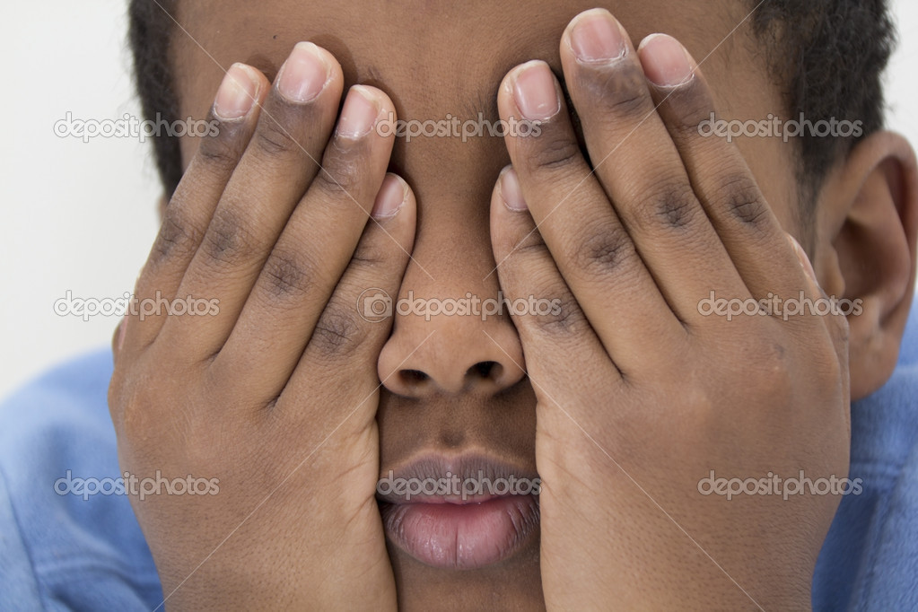A young boy playing hide and seek covering his eyes with his hands  Stock Photo #4899117