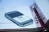 Phone on a datebook — Stock Photo