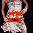 Girl holding Disaster Area board — Stock Photo