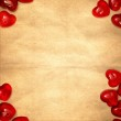 Yellow paper and red hearts — Stock Photo #4848507