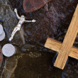 Cross, coins and Jesus figure. — Stock Photo