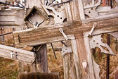 Broken Jesus figure on an old cross — Stock Photo