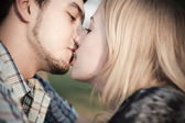 Kiss with a surprise — Stock Photo