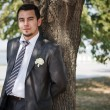 Handsome Groom outdoors — Stock Photo