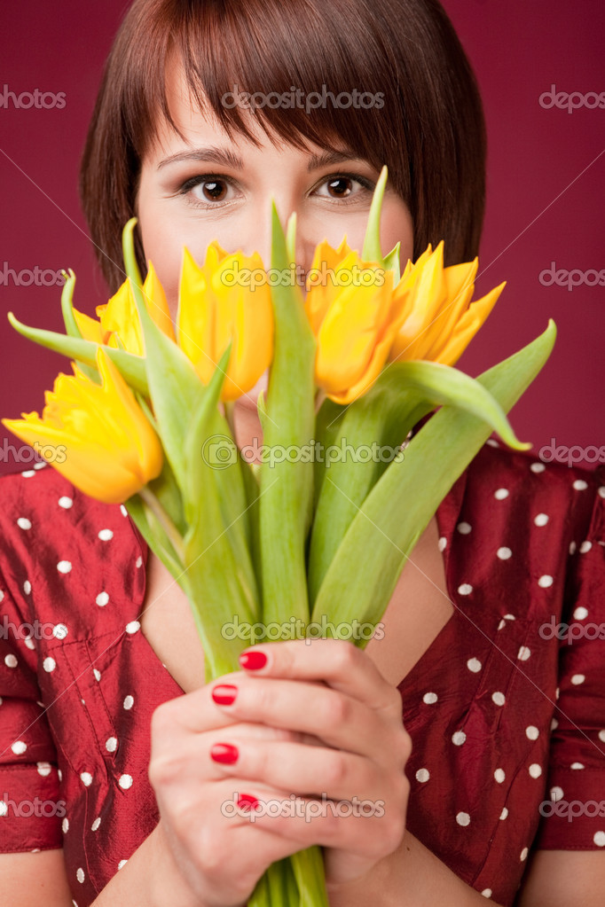 Happy woman is holding a bunch og tulips — Stock Photo #5326361