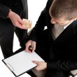 Closeup of a businessman signing a contract beeing bribed — Stock Photo
