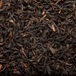 Black tea background - Stock Photo