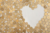 Coins with heartshaped textfield — Stock Photo