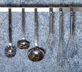 Kitchen tools hanging — Stock Photo