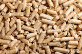 Wood pellets background — Stock Photo