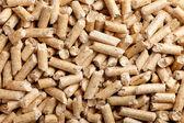 Wood pellets background — Stock Photo