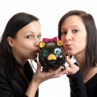 Two young women piggy bank kissing — Stock Photo
