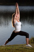 Young woman yoga lake — Stock Photo