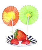 Strawberry berries on a striped saucer with decorative peaks — Stock Photo
