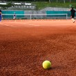 Kids playing Tennis - Stock Photo