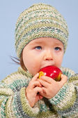 Young Boy is eating an Apple — Stock Photo