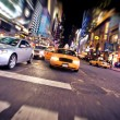 Blurred image of yellow taxi cab - Stock Photo