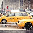 Stock Photo: Taxi Cabs cautiously maneuvering through blizzard