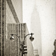 Old-fashioned stylization of silhouette of Empire State building in blizzar — Stock Photo #4791649