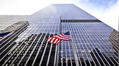Flag of the United States of America in front of the office building. — Stock Photo