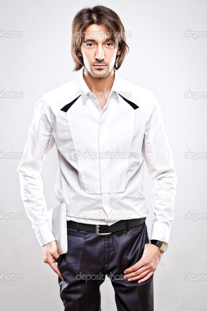 Young serious man in sunglasses and white shirt  Stock Photo #5372886