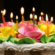 Burning color candles on a celebratory pie — Stockfoto