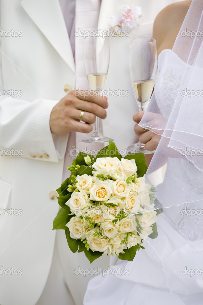 Bride and fiance hold glasses of champagne  Stock Photo #4751989