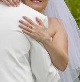 Wedding moments - bride embraces fiance — Stock Photo