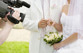 Filming a newly-married couple — Stock Photo