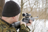 Sniper takes aim — Stock Photo