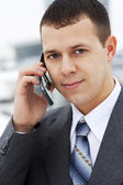 Successful young businessman talking on the phone — Stock Photo