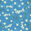Seamless spring floral pattern on a blue background — Stock Vector #4871732