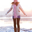 Positive smiling girl in winter clothes - jumping — Stock Photo