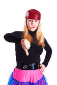 A girl dressed as a pirate with a thumb down — Stock Photo