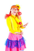 A girl dressed as Pippi Longstocking juggling — Stock Photo