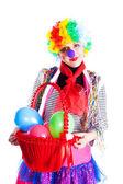 Meisje in heldere carnaval kostuums met een mandje met ballonnen — Stockfoto