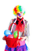 Girl in bright carnival costumes with a basket of balloons — Stock Photo