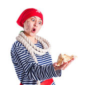 Girl dressed as a pirate with a seashell — Stock Photo