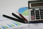 Financial concept. Calculator and pen. — Stock Photo