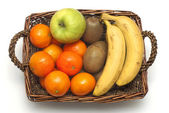 Wicker basket with fruits — Stock Photo