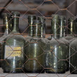 Old bottles in storage shelves — Stock Photo
