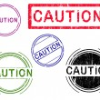 5 Grunge Stamps - CAUTION - Stock Vector
