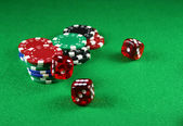 An Action shot of 5 dice thrown onto the table — Stock Photo