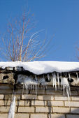 Icicles and root on the roof — Stock Photo