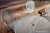 Silvery metal table and chairs — Stock Photo