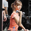 Young woman with dumbbell in fitness club — Stock Photo #4829420