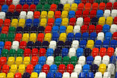 Perspective of rows multicolored seats on the sport tribune — Stock Photo