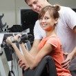 Exercise in health club — Stock Photo #4857986