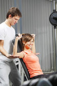 Exercise in health club — Stock Photo