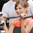 Girl and her trainer in fitness club — Stock Photo